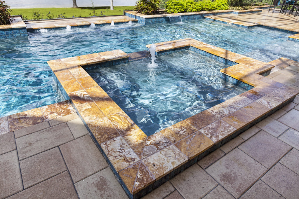 GE Smith Electric swimming pool with spa and outdoor living space